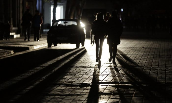 People walk along a street in the dark (Max Vetrov/AFP/Getty Images)