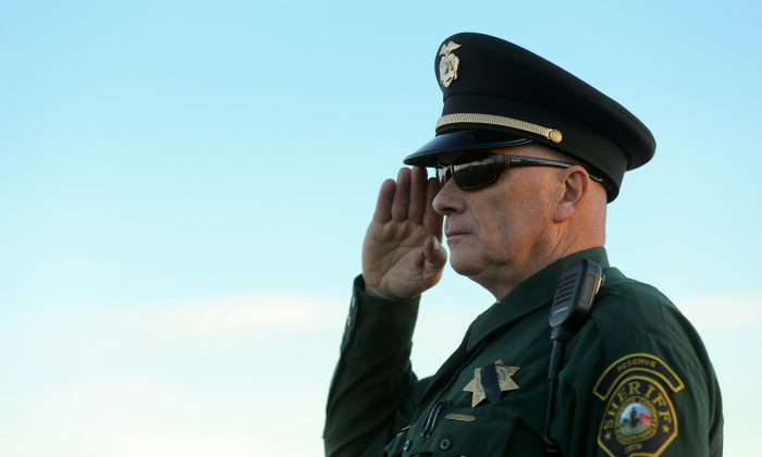 An officer salutes following funeral services for police officer Garrett Swasey at New Life Church in Colorado Springs, Colo., on Dec. 4, 2015. Swasey was killed in the line of duty on Nov. 27 when a gunman opened fire at a Planned Parenthood clinic. (Justin Edmonds/Getty Images)