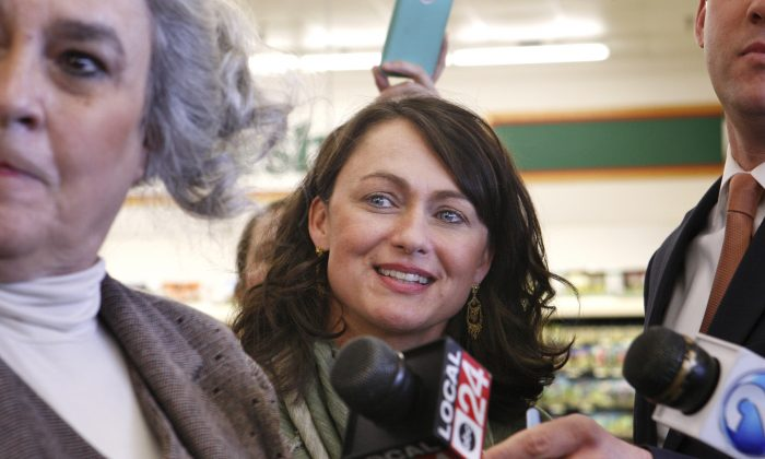 Dana Naifeh, center, one of the owners of Naifeh's Grocery in Munford, Tenn., attends the announcement Thursday, Jan. 14, 2016, that one of the winning Powerball tickets in Wednesday's record jackpot drawing of $1.6 billion was sold at the store. (AP Photo/Karen Pulfer Focht)