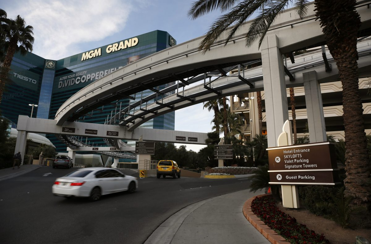 In this photo taken Thursday, Jan. 14, 2016, cars drive into the MGM Grand hotel and casino in Las Vegas. Casino giant MGM Resorts International will announce Friday, Jan. 15, that it plans to begin charging visitors for parking this year at some of its properties in Las Vegas. (AP Photo/John Locher)