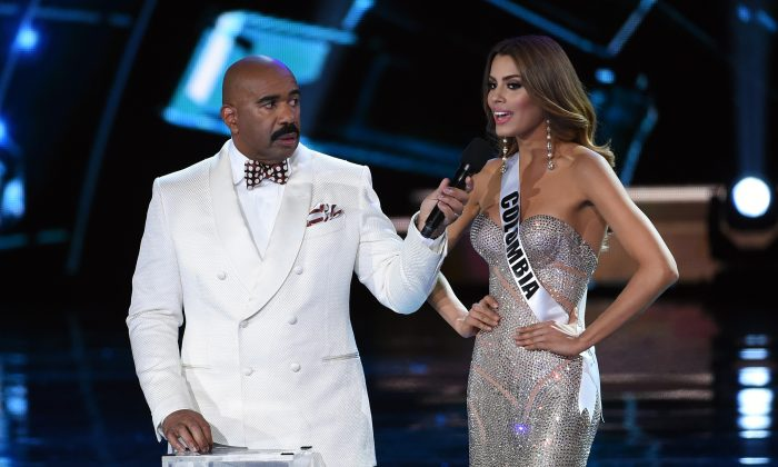 Host Steve Harvey (L) listens as Miss Colombia 2015, Ariadna Gutierrez Arevalo, answers a question during the interview portion of the 2015 Miss Universe Pageant at The Axis at Planet Hollywood Resort & Casino on December 20, 2015 in Las Vegas, Nevada. Gutierrez went on to be named the first runner-up. (Photo by Ethan Miller/Getty Images)