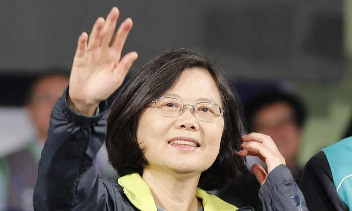 Democratic Progressive Party leader Tsai Ing-wen waves to supporters in Kaohsiung, Taiwan, on Jan. 9, 2016, a week before winning the presidential election. (AP Photo/Wally Santana)