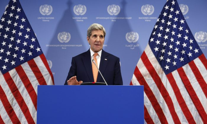 U.S. Secretary of State John Kerry delivers a statement that sanctions will be lifted on Iran after the International Atomic Energy Agency (IAEA) verified that Iran has met all conditions under the nuclear deal, in Vienna, Saturday Jan. 16,  2016. (Kevin Lamarque/Pool via AP)