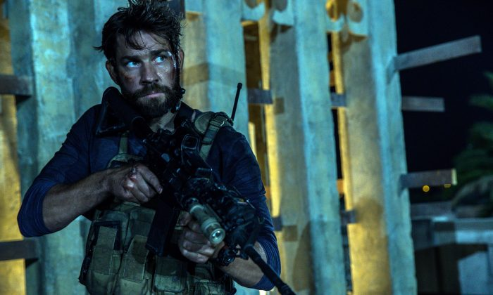 """In this photo provided by Paramount Pictures shows John Krasinski as Jack Silva in the film, """"13 Hours: The Secret Soldiers of Benghazi"""" from Paramount Pictures and 3 Arts Entertainment/Bay Films. The movie releases in U.S. theaters Jan. 15, 2016. (Christian Black/Paramount Pictures via AP)"""