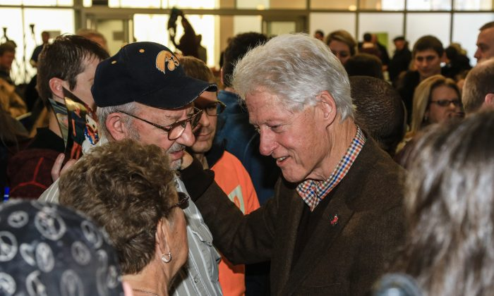 Former President Bill Clinton meets with members of his audience after speaking at a campaign event for his wife, Democratic presidential candidate Hillary Clinton, at Morningside College in Sioux City, Iowa, on Jan. 15, 2016. (AP Photo/Nati Harnik)