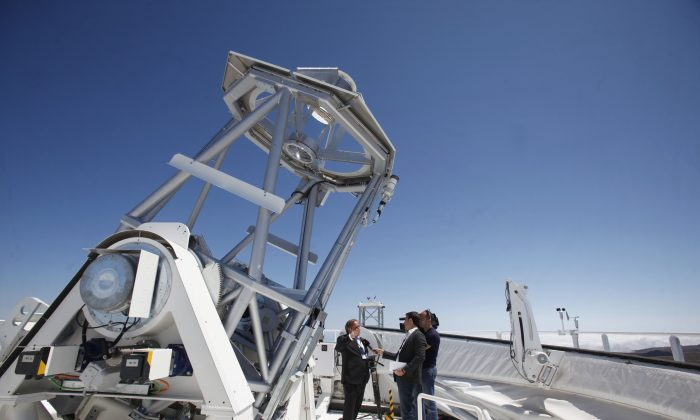 Klaus Pushmann (L), one of the constructors of German Solar Telescope GREGOR, the biggest in Europe and third largest in the world, talks to journalists during its inauguration in the National Park of El Teide, on the Spanish Canary island of Tenerife, on May 21, 2012. (Desiree Martin/AFP/Getty Images)