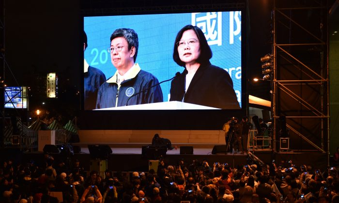 A giant screen showing a broadcast of Democratic Progressive Party (DPP) presidential candidate Tsai Ing-wen (R) is seen as supporters gather outside the party headquarters in Taipei on Jan. 16, 2016. Tsai Ing-wen of Taiwan's main opposition party was on course for a landslide election victory January 16, a win that would make her the island's first female president as voters turn their backs on closer China ties. (Sam Yeh/AFP/Getty Images)