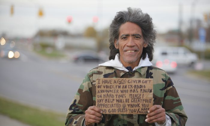 Ted Williams holds a sign advertising his smooth radio voice near a highway ramp in Columbus, Ohio, on December 2010. Five years after Williams' silky voice won him Internet fame, he's on the air again at the same Ohio radio station where he began his career before addiction pushed him to the streets. The Columbus Dispatch reports the new weekday radio program on WVKO-AM is the first steady employment Williams has had since 1993. (AP Photo/Columbus Dispatch, Doral Chenoweth III)