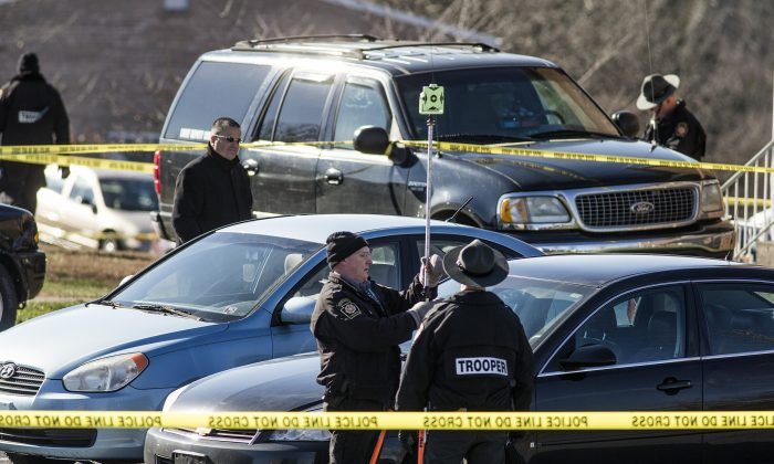 In this Monday, Jan. 11, 2016 photo, State police investigate the scene of a deadly shooting at Pfautz Rentals apartments in Penn Township, Pa. Authorities said a 12-year-old girl was shot and killed during a confrontation between her father and a state constable serving an eviction order at their central Pennsylvania apartment. (Dan Gleiter/PennLive.com via AP)