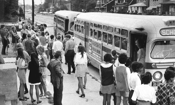 White pupils from outlying areas of Norfolk arrive by bus on Sept. 4, 1970 at inner-city Booker T. Washington High School in Norfolk, VA, formerly almost all-black, on the opening day of schools under a court-ordered desegregation plan requiring massive busing. (AP Photo)