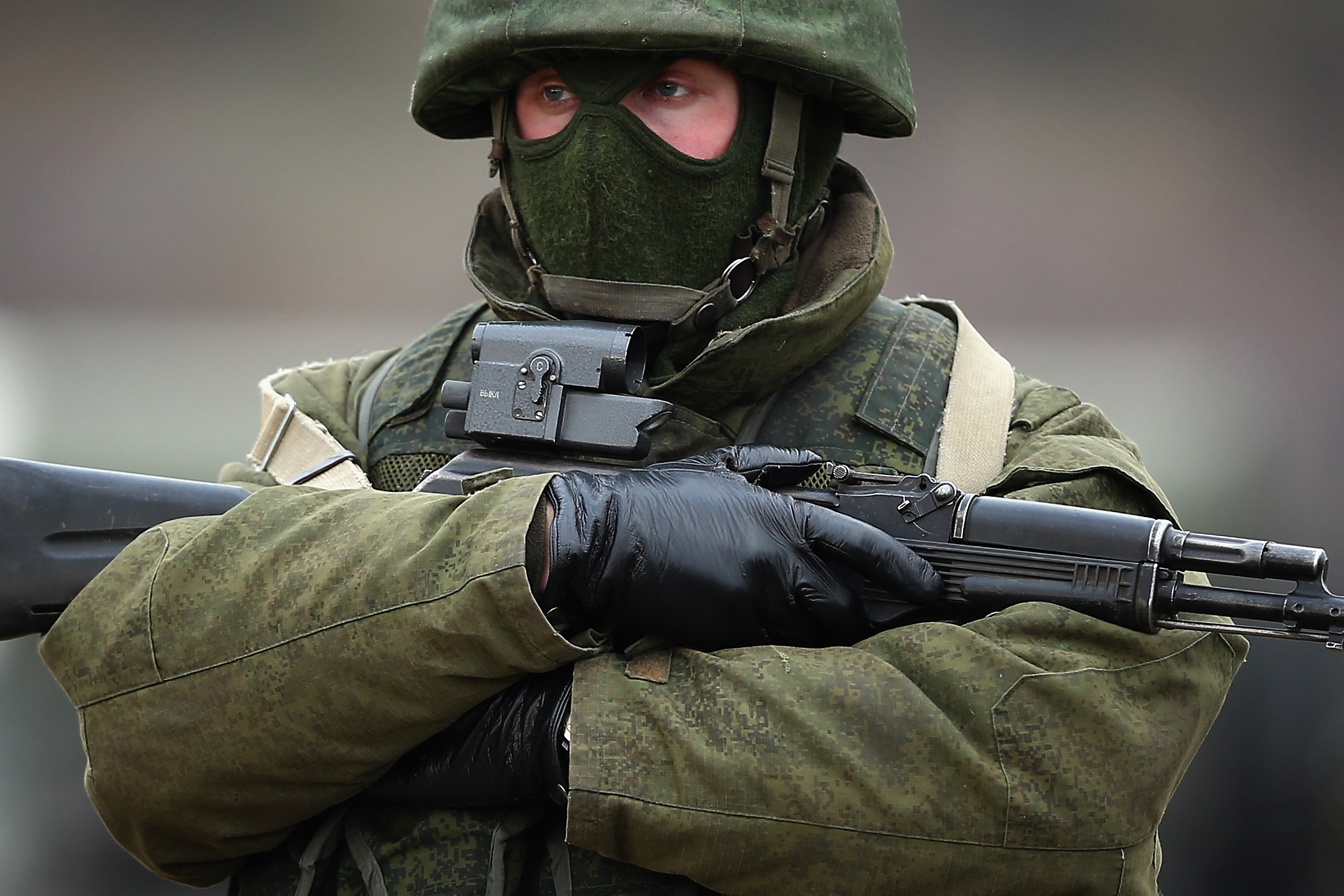 Armed men believed to be Russian military patrol outside a Ukrainian military base in Simferopol, Ukraine, on March 12, 2014. (Dan Kitwood/Getty Images)