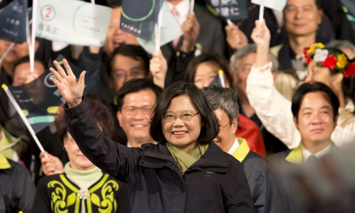President-elect Tsai Ying-wen waves to supporters at her Democratic Progressive Party (DPP) headquarter in Taipei, Taiwan, on Jan. 16, 2016. Tsai, the chairwoman of the opposition DPP, won the presidential election to become the Taiwan's first female leader. (Ashley Pon/Getty Images)