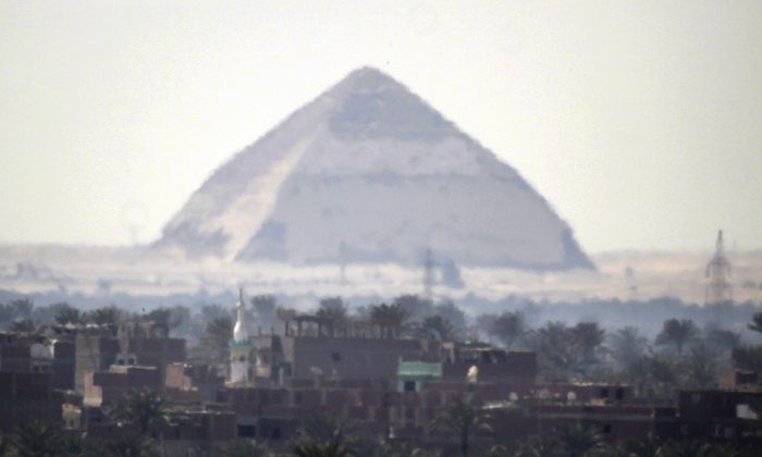 The 4,500-year-old Bent Pyramid is seen in Dahshour near Cairo, Egypt, on March 24, 2009. An international heritage research group says scientists will begin analyzing radiographic muons, or cosmic particles, collected from the ancient Bent Pyramid built by the Pharaoh Snefru. (AP Photo/Amr Nabil)
