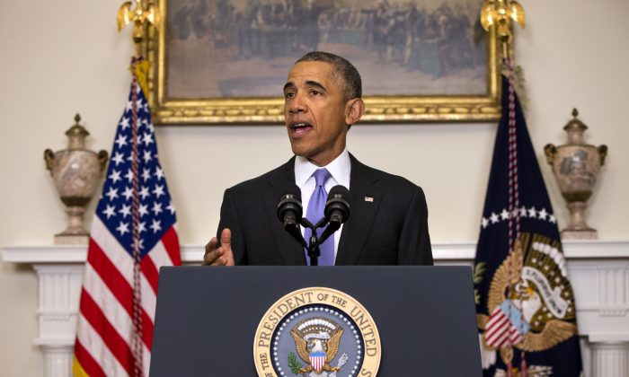 President Barack Obama speaks about the release of Americans by Iran, in the Cabinet Room of the White House in Washington, D.C., on Jan. 17, 2016. (AP Photo/Jacquelyn Martin)