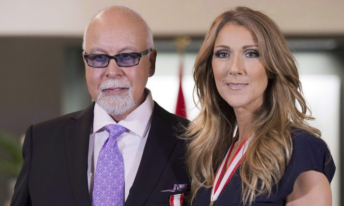 Canadian music star Celine Dion (R) and husband Rene Angelil posing for photos after being decorated with the Order of Canada in Quebec City on July 26, 2013. Authorities say Angelil, the husband and manager of Dion, has died in Las Vegas. He was 73 and had battled throat cancer. Clark County Coroner John Fudenberg said his office was notified Thursday, Jan. 14, 2016, of Angelil's death. (Jacques Boissinot/The Canadian Press)