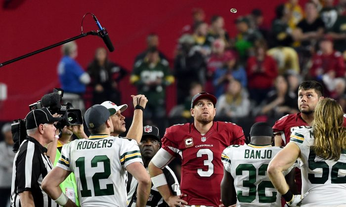 The coin toss to determine possession is maybe the most important part of an NFL overtime period. (Norm Hall/Getty Images)