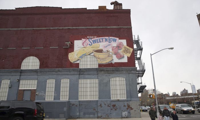 The Cumberland Packing Corp. headquarter is seen in the Brooklyn borough of New York on Jan. 12, 2016. After nearly 60 years, the New York City factory that makes the sugar substitute Sweet'N Low will soon be stopping local production. The family-owned company told workers that production would stop in Brooklyn over the year and shift entirely to other parts of the country, leaving only headquarters in the borough. (AP Photo/Mary Altaffer)