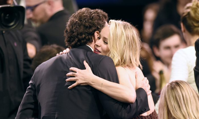 """Brian d'Arcy James, left, hugs Rachel McAdams in the audience after hearing that they won the award for best picture for """"Spotlight"""" at the 21st annual Critics' Choice Awards at the Barker Hangar on Sunday, Jan. 17, 2016, in Santa Monica, Calif. (Photo by Chris Pizzello/Invision/AP)"""