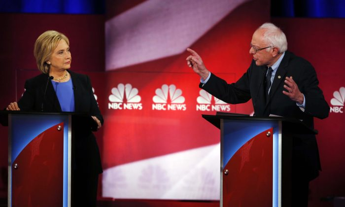 Democratic presidential candidates Sen. Bernie Sanders (I-Vt.) (R) and Hillary Clinton at the NBC, YouTube Democratic presidential debate at the Gaillard Center in Charleston, S.C., on Jan. 17, 2016. (AP Photo/Mic Smith)