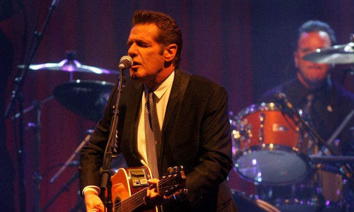 In this March 20, 2010 file photo, Glenn Frey of the Eagles performs at Muhammad Ali's Celebrity Fight Night XVI in Phoenix, Arizona. The Eagles said band founder Frey died Monday, Jan. 18, 2016, in New York after battling multiple ailments. He was 67. (AP Photo/Ralph Freso, File)