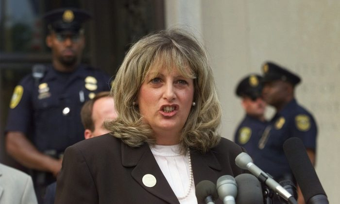 Linda Tripp, the Pentagon employee whose secret tape recordings of former White House intern Monica Lewinsky triggered a criminal investigation of President Clinton, talks to reporters outside federal court in Washington Wednesday, July 29, 1998, after making her final appearance before the grand jury that's looking into allegations of a sexual relationship between Lewinsky and President Clinton. (AP Photo/Doug Mills)