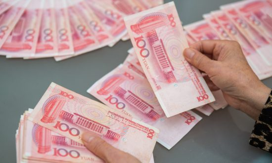 Will China Central Bank's Debt Bomb Blow Up the Yuan?
