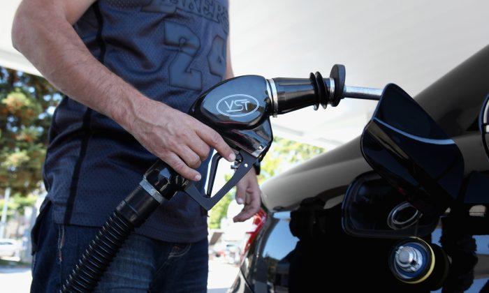 Chevron customoer Jason Glavis prepares to pump gas into his car at a Chevron gas station August 13, 2010 in San Rafael, California. (Justin Sullivan/Getty Images)