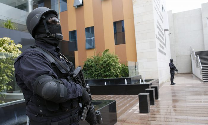 Members of the Moroccan special anti-terror unit guard the headquarters of the Central Bureau of Judicial Investigations in Sale near Rabat, Morocco, Tuesday, Jan. 5, 2016. (AP Photo/Abdeljalil Bounhar)