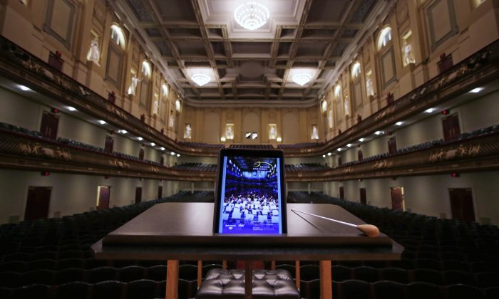 In this Friday, Jan. 15, 2016, photo, an iPad with a Boston Symphony Orchestra interactive program is displayed on the conductor's stand at Symphony Hall in Boston. (AP Photo/Charles Krupa)