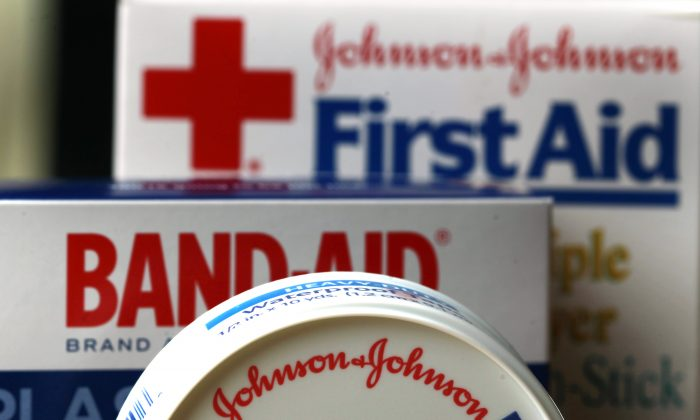 In this Monday, July 16, 2012 photo, Johnson & Johnson products are displayed in Orlando, Fla. Johnson & Johnson announced Tuesday, Jan. 19, 2016, that the company expects to cut about 3,000 jobs over the next two years as the health care conglomerate works to restructure its medical devices business. (AP Photo/John Raoux, File)
