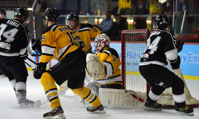 Goalmouth action in the match between South China Sharks and Hong Kong Tycoons in the CIHL in Hong Kong on Thursday Jan 14, 2016. Tycoons scooped an 8-6 win by pulling out 2-goals late in the 3rd session. (Cox/Epoch Times)