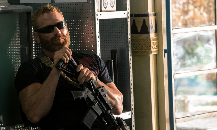 "In this photo provided by Paramount Pictures shows Max Martini as Oz in the film, ""13 Hours: The Secret Soldiers of Benghazi"" from Paramount Pictures and 3 Arts Entertainment/Bay Films.  (Christian Black/Paramount Pictures via AP)"