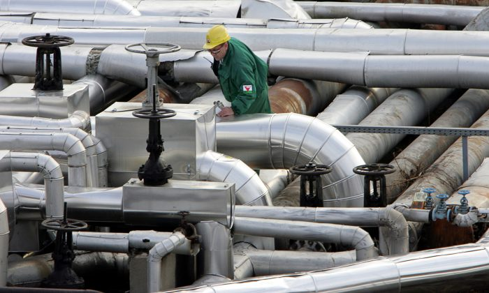 An engineer checks the refinery plant at the receiving station of the oil pipeline Druzhba in Szazhalombatta, some 30 kms south of Budapest, Hungary, on Jan. 9, 2007. (Attila Kisbenedek/AFP/Getty Images)