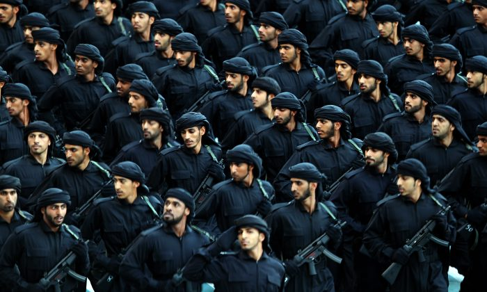 Emirati troops march during celebrations marking the 40th anniversary of the establishment of the United Arab Emirates at Sheikh Zayed Sports City in Abu Dhabi on December 2, 2011. (Photo credit should read KARIM SAHIB/AFP/Getty Images)