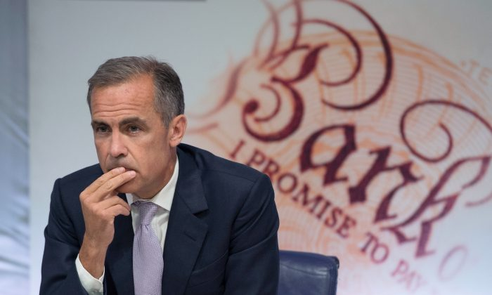 Bank of England Governor Mark Carney at the quarterly inflation report press conference at the Bank of England in London, England, on Aug. 6, 2015. (Anthony Devlin/Getty Images)