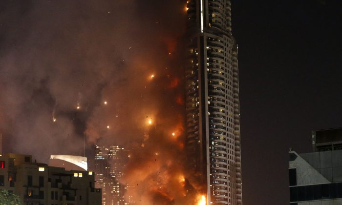 Flames rip through the Address Downtown hotel after it was hit by a massive fire, near the world's tallest tower, Burj Khalifa, in Dubai, on December 31, 2015. (KARIM SAHIB/AFP/Getty Images)