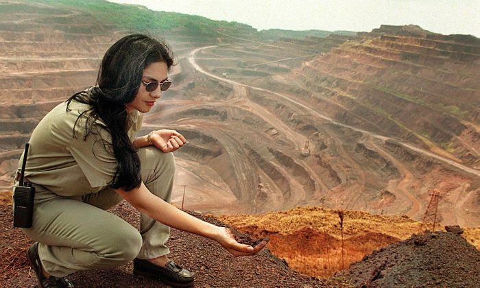 An employee at the Vale do Rio Doce mining company shows iron deposit at the strip mine of Carajas, in the heart of the Amazon Forest in northern Brazil, on Aug. 30, 1999. Carajas is the largest iron ore mine in the world, and also exploits gold, manganese, copper, and nickel. (Vanderlei Almeida/AFP/Getty Images)
