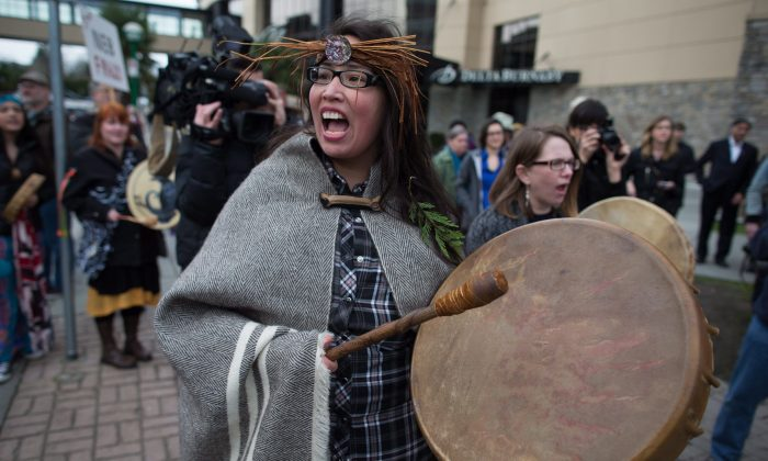 Audrey Siegl of the Musqueam First Nation chants and beats a drum during a protest outside National Energy Board hearings on the proposed Trans Mountain pipeline expansion in Burnaby, B.C., on Jan. 19, 2016. (THE CANADIAN PRESS/Darryl Dyck)