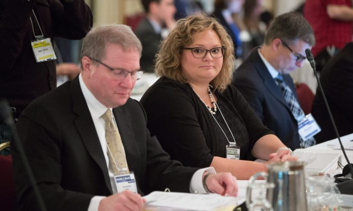Alberta Health Minister Sarah Hoffman and deputy minister Carl Amrhein (L) attend a meeting of provincial and territorial health ministers in Vancouver on Jan. 20, 2016. The federal government has joined the provinces and territories in a program to buy drugs in bulk. (THE CANADIAN PRESS/Darryl Dyck)