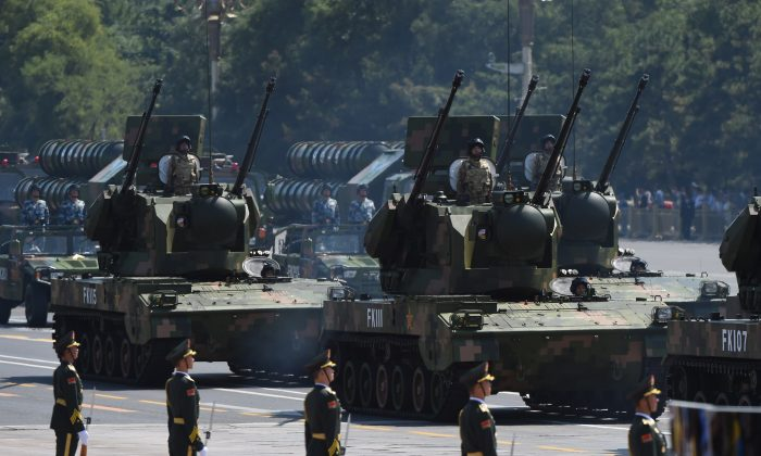 The Chinese military displays its equipment during a military parade at Tiananmen Square in Beijing on Sept. 3, 2015. Author and filmmaker Peter Navarro warns that China may be on the path to war. (Greg Baker/AFP/Getty Images)