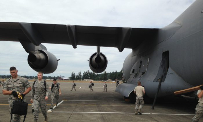 In this June 18, 2015, photo provided by the Washington State Army National Guard, airmen from the 242nd Combat Communications Squadron at Fairchild Air Force Base exit and unload a C-17 flown by the 446th Airlift Wing at Gray Army Airfield at Joint Base Lewis-McChord as part of Exercise Evergreen Tremor, a rehearsal of the emergency management and military response in the event of a catastrophic Cascadia Subduction Zone earthquake.  (2nd Lt. Hans Zeiger/Washington State Army National Guard via AP)