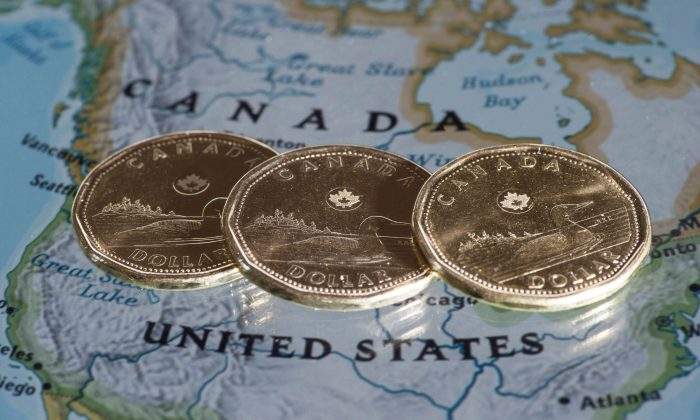 The weakening loonie makes Canadian companies cheaper for Americans to invest in. This could be a much-needed boost for the startup ecosystem. (The Canadian Press/Paul Chiasson)
