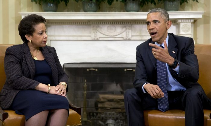FILE - In this May 29, 2015 file photo, President Barack Obama talks with Attorney General Loretta Lynch in the Oval Office of the White House in Washington. (AP Photo/Carolyn Kaster, File)