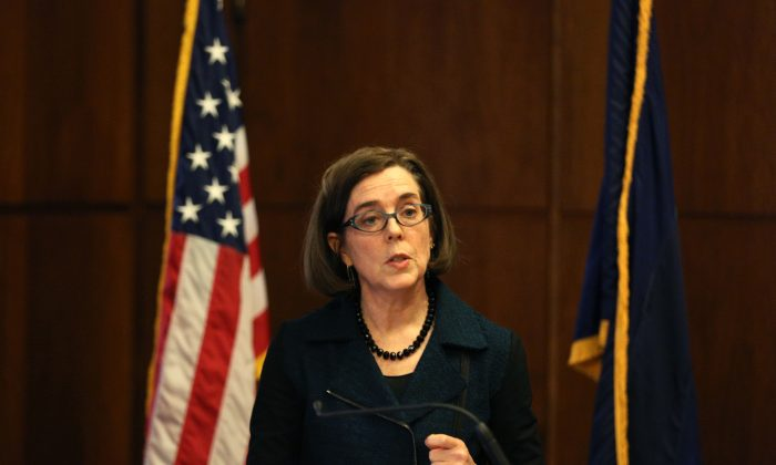 Oregon Gov. Kate Brown outlines her 2016 policy agenda at a press conference at the State Capitol in Salem, Ore., on Jan. 20, 2016. Brown said she is angry federal authorities have not yet taken action against an armed group occupying a national wildlife refuge in southeastern Oregon and said she plans to bill the U.S. government for what it has been costing Oregon taxpayers. (Molly J. Smith/Statesman-Journal via AP)