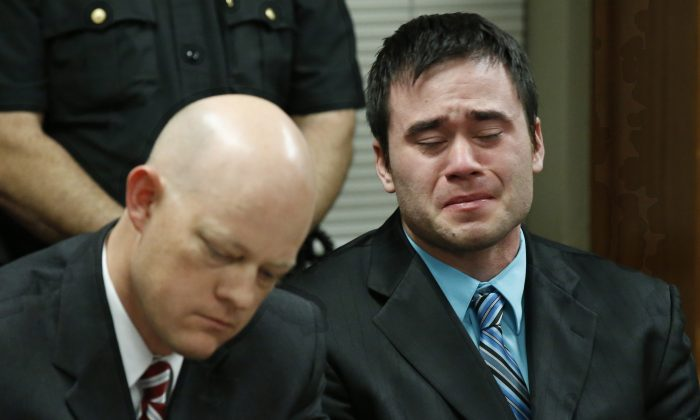 Daniel Holtzclaw, right, cries as the verdicts are read in his trial in Oklahoma City, Thursday, Dec. 10, 2015. (AP Photo/Sue Ogrocki)
