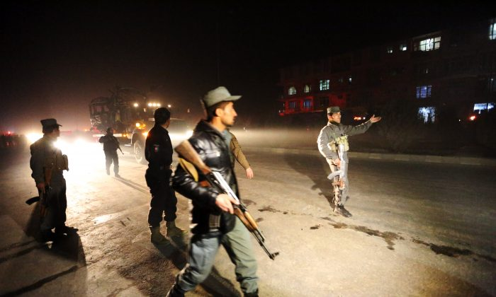 Afghan security forces inspect the site of a suicide attack near the Russian embassy in Kabul, Afghanistan, Wednesday, Jan. 20, 2016. (AP Photo/Rahmat Gul)