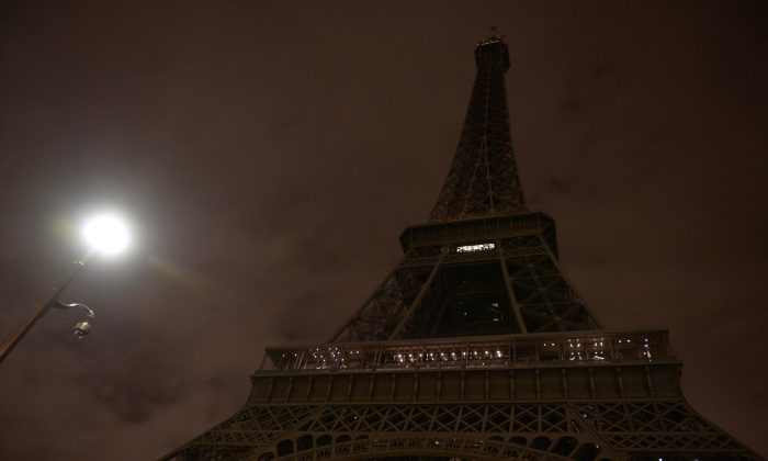 The Eiffel Tower with its lights turned off following the deadly attacks in Paris on Nov. 14, 2015. (Alain Jocard/AFP/Getty Images)