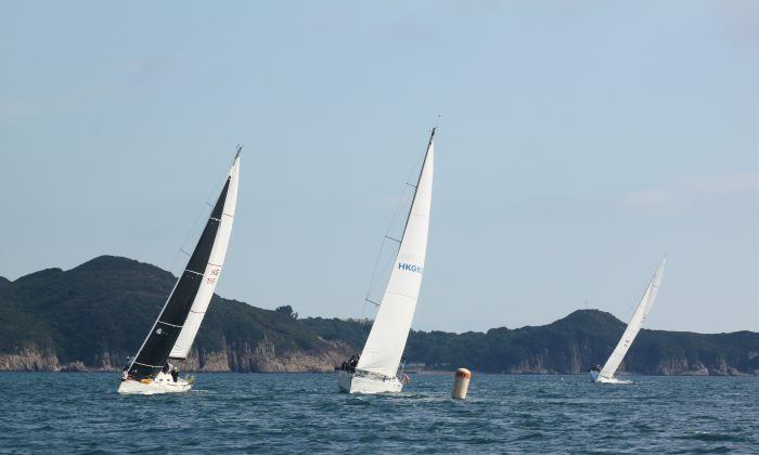 (L to R) 'Talkinghead', 'Ichiban' and 'Outrageous' that finished in 33rd, 2nd and 6th place overall respectively rounding a mark in the Pursuit Race (Race-2) of the Hebe Haven Yacht Club Kowloon Cup on Sunday Jan 17, 2016. (Vivian Ngan)