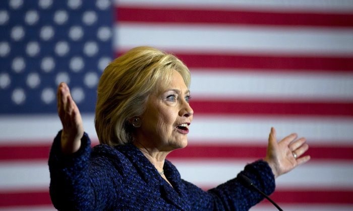 In this Jan. 21, 2016, photo, Democratic presidential candidate Hillary Clinton gestures while speaking during a rally on the campus of Simpson College in Indianola, Iowa. (AP Photo/Jae C. Hong)