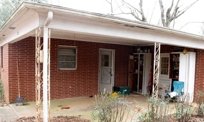 The carport of a home in Statesville, N.C., is pictured on Wednesday, Jan. 20, 2016, where a man was shot and killed by sheriff's deputies the day before. The Iredell County sheriff's deputies were trying to serve an eviction notice on Samuel Edward Grady, 55,, when investigators say he lunged at the deputies with a large knife. (AP Photo/Skip Foreman)